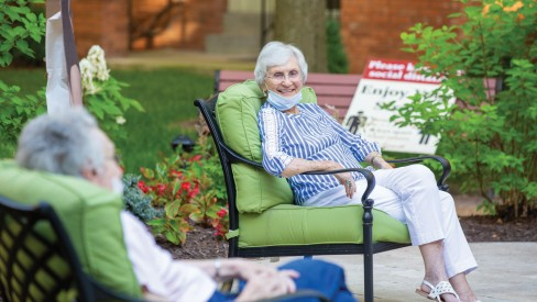 Residents sitting outside while social distancing