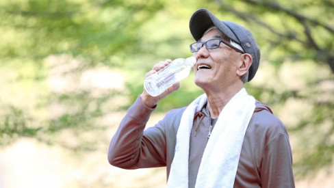 A man drinks water after outdoor activities